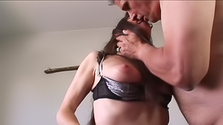 The lovely milf with glasses is teasing her pussy in front of us