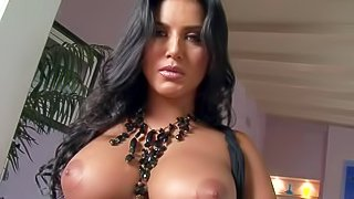 Sunny Leone is a raven haired beauty goddess with a pair of nice huge melons. Shaved pussy babe pulls out her big melons before she pulls off her black panties and opens her legs