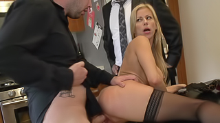 A blonde with large tits is getting a dick in her pussy in the kitchen