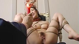 Hot wax covers the slutty pussy of a tied up Japanese girl