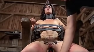 Nasty babe's pussy stretched by kinky toys during a BDSM game